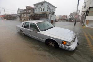 ATLANTIC CITY, NJ - OCTOBER 29:  A car sits in a flooded street near the ocean ahead of Hurricane Sandy on October 29, 2012 in Atlantic City, New Jersey. Governor Chris ChristieÄôs emergency declaration is shutting down the cityÄôs casinos and 30,000 residents were ordered to evacuate. (Photo by Mario Tama/Getty Images)