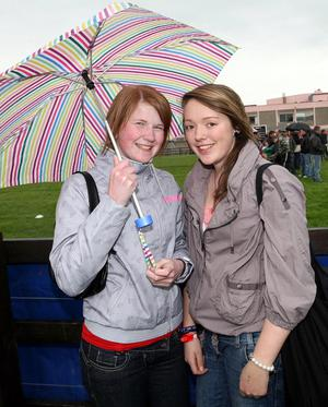 Kim Robinson and Nicola Greer Shelter from the rain at the Balmoral Show