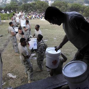 US soldiers unload disaster relief supplies in Port-au-Prince, Haiti (AP)