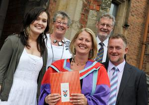 Queen's University summer Graduation.  Dr Bronagh McKee, from Ballymoney, received her PhD in Child Protection Education from Queen's University.  She was accompanied by her daughter Taylor McKee, husband Alistair Steele and parents Don and Dorothy McKee.