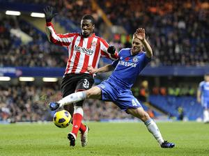 Sunderland's Asamoah Gyan (left) and Chelsea's Joshua McEachran battle for the ball during the Barclays Premier League match at Stamford Bridge, London. PRESS ASSOCIATION Photo. Picture date: Sunday November 14, 2010. See PA Story SOCCER Chelsea. Photo credit should read: Rebecca Naden/PA Wire. RESTRICTIONS: Use subject to restrictions. Editorial print use only except with prior written approval. New media use requires licence from Football DataCo Ltd. Call +44 (0)1158 447447 or see www.pressassociation.com/images/restrictions for full restrictions.