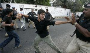 Pakistani protesters who try to reach the US Consulate, confront police officers during a rally denouncing Israel's raid on ships taking humanitarian aid to the blockaded Gaza Strip, Tuesday, June 1, 2010