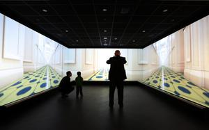 BELFAST, NORTHERN IRELAND - MARCH 27: Visitors look at a computer video projection of the interior of The Titanic at the Titanic Belfast visitor attraction on March 27, 2012 in Belfast, Northern Ireland. The Titanic Belfast Experience is a new £90 million visitor attraction opening on March 31, 2012. One hundred years ago the maiden voyage of the ill-fated passenger liner Titanic sank after hitting an iceberg in the Atlantic on the night of April 14, 1911 with the loss of 1517 lives.  (Photo by Peter Macdiarmid/Getty Images)