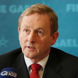 Fine Gael leader Enda Kenny said a bailout of the Irish economy must allow a new government to revise the budget plan