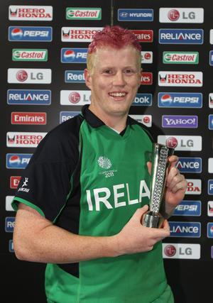 BANGALORE, INDIA - MARCH 02:  Kevin O'Brien of Ireland poses with the man of the match trophy during the 2011 ICC World Cup Group B match between England and Ireland at the M. Chinnaswamy Stadium on March 2, 2011 in Bangalore, India.  (Photo by Tom Shaw/Getty Images)