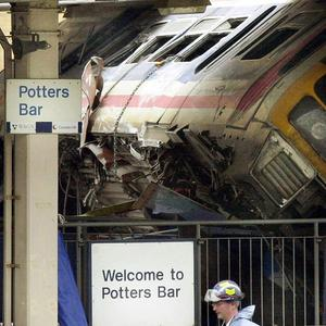 The crash killed six people on the train and one passer-by who was struck by debris