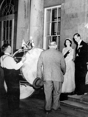 The Queen, Elizabeth 11. 1953. Coronation Year visit.The Queen and Duke chat with two traditional Lambeg drummers on the steps of Government House, Hillsborough.  1/7/1953