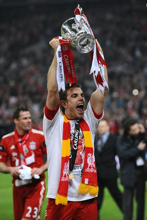 Liverpool's Jordan Henderson celebrates victory during the Carling Cup Final at Wembley Stadium, London