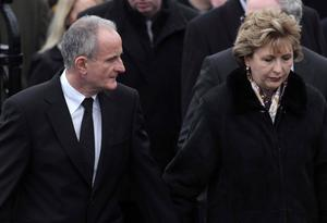 Funeral of Cork plane crash victim Brendan McAleese takes place at St MacNissus church in Tannaghmore, Co Antrim. Mr McAleese was a cousin of Irish President Mary McAleese's husband Martin.  Martin and President Mary McAleese leave the church after the service.