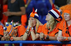 KHARKOV, UKRAINE - JUNE 13:  Netherlands fans look dejected after the UEFA EURO 2012 group B match between Netherlands and Germany at Metalist Stadium on June 13, 2012 in Kharkov, Ukraine.  (Photo by Ian Walton/Getty Images)