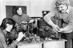 The three pupils of St. Augustine's Secondary School, Ravenhill Road, Belfast (from left), John Hanna, Harry Pye and William Jones busy at work on disregarded television sets getting them in working order for the old age pensioners, 1972.
