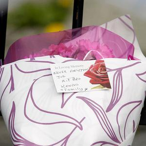 Flowers left at the scene of a shooting in Liverpool