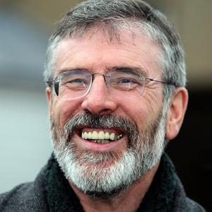 Gerry Adams says it is important that the handshake between Britain's Queen Elizabeth and Martin McGuinness is seen as more than just a gesture