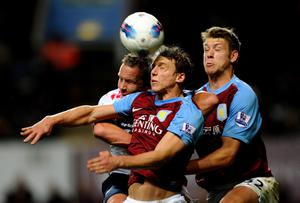 BIRMINGHAM, ENGLAND - APRIL 24:  Kevin Davies of Bolton Wanderers goes up for a header with Stephen Warnock and Nathan Baker (R) of Aston Villa the Barclays Premier League match between Aston Villa and Bolton Wanderers at Villa Park on April 24, 2012 in Birmingham, England.  (Photo by Laurence Griffiths/Getty Images)