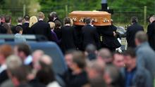 Mourners attend the funeral of Mark McLaughlin at St Mary's Church in Fahan, Co Donegal