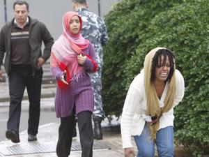 An Ethiopian woman, right, a relative of passengers of an Ethiopian Airlines plane that crashed in the sea, reacts upon her arrival at Beirut airport, Lebanon, Monday, Jan. 25, 2010.