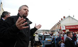 Fr Gary Donegan speaks to residents in Ardoyne during a rally at Brompton Park to highlight opposition against those who have been  rioting in the area in recent nights