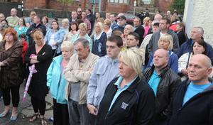 Ardoyne residents attend a rally at Brompton Park to highlight opposition to those who have been  rioting in the area in recent nights