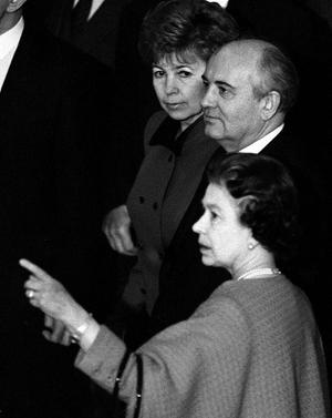 File photo dated 07/04/1989 of Queen Elizabeth II pointing out portraits lining the walls of the Waterloo Chamber to Soviet President Mikhail Gorbachev, and his wife Raisa, at Windsor Castle, during their two-day visit to Britain. PRESS ASSOCIATION Photo.