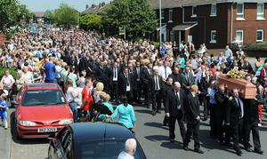 Family and friends helping to carry murdered man Bobby Moffett's coffin from the family home off the Shankill Road