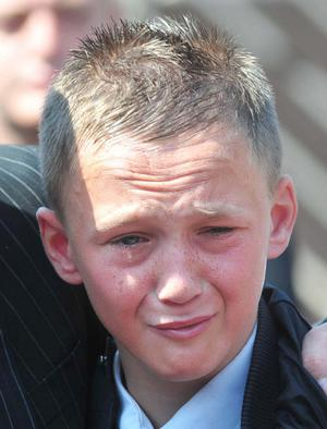 A young family member of Bobby Moffett during his funeral