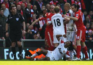 Nani of Manchester United lies on the pitch following a challenge by Jamie Carragher of Liverpool during the Barclays Premier League match between Liverpool and Manchester United at Anfield on March 6, 2011