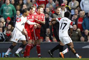 Manchester United's Nani (right) complains to referee Phil Dowd after a tackle by Liverpool's Jamie Carragher (second left) during the Barclays Premier League match at Anfield, Liverpool on March 6, 2011
