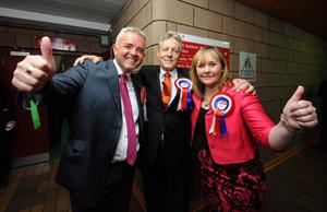 First Minister and DUP leader Peter Robinson with Michelle McIlveen and Jonathan Bell who won seats in the Strangford election at the count in Newtownards Leisure Centre
