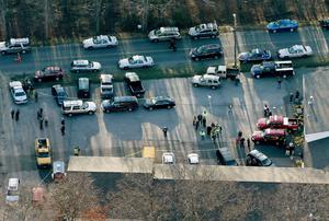 NEWTOWN, CT - DECEMBER 14:  People gather at a fire station that was set up as a triage area near the scene of a mass school shooting at Sandy Hook Elementary School on December 14, 2012 in Newtown, Connecticut. There are 27 dead, 20 of them children, after Adam Lanza reportedly opened fire in one of the largest school massacres in U.S. history. Lanza is dead at the scene and his mother, a teacher at the school, is also dead.  (Photo by Mario Tama/Getty Images)
