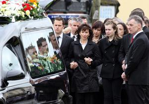 PSNI Constable Ronan Kerr's mother Nuala and family follow Ronan's coffin through their  home town of Beragh in Co Tyrone, to the Church of the Immaculate Conception for his funeral