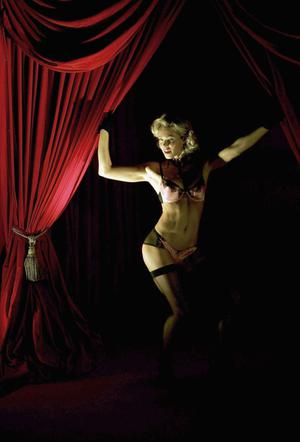 Nell McAndrew models at the Agent Provocateur charity fashion show