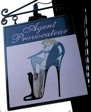 A Agent Provocateur sign in a street of London.