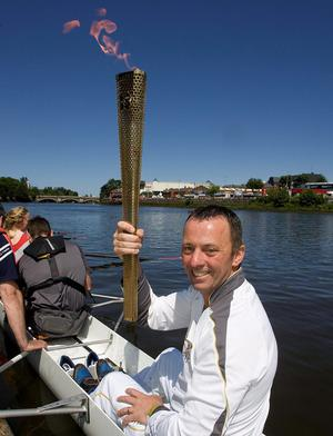 Seamus Reynolds, coach at the Bann Rowing Club in Coleraine, with the torch