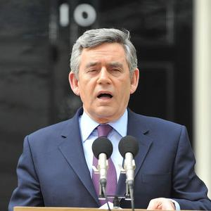 Gordon Brown is to step down as Labour leader, but remains in talks with the Lib Dems over a possible coalition