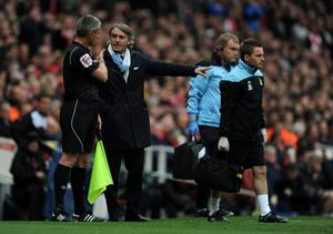 LONDON, ENGLAND - APRIL 08: Man City manager Roberto Mancini has words with the fourth official during the Barclays Premier League match between Arsenal and Manchester City at Emirates Stadium on April 8, 2012 in London, England.  (Photo by Michael Regan/Getty Images)
