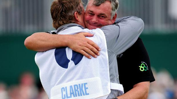 SANDWICH, ENGLAND - JULY 17:  Darren Clarke of Northern Ireland embraces his caddy John Mulrooney on the 18th green following his victory during the final round of The 140th Open Championship at Royal St George's on July 17, 2011 in Sandwich, England.  (Photo by Stuart Franklin/Getty Images)