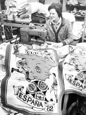 Participation in the 1982 World Cup finals has heightened pride in Northern Ireland. Here Mrs. Dorothy McBride, a stitcher in Riverside Textiles, Antrim, works on a World Cup tea towel