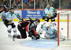 Stuart MacRae of the Cardiff Devils shoots the first goal past Stephen Murphy of the Belfast Giants