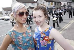 Gemma McCullough and Andreena McCurdy enjoy the sunshine during the North Antrim parade in Ballycastle. Pic Steven McAuley/Kevin McAuley Photography Multimedia