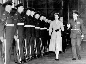 The Queen, Elizabeth 11. 1954 visit.When she arrived at Aldergrove the Queen inspected a guard of honour mounted by the R.A.F. As she passed doen the line she was accompained by Flt-Lt. A.S.Bouttell, who commanded the guard.  17/8/1954