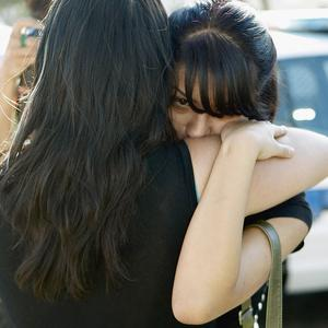 Gardena High School student Wilma Briseno, right, is comforted by her mother, left, as she comes out of the school following reports of a shooting (AP)