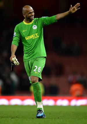 LONDON, ENGLAND - APRIL 16: Maynor Figueroa of Wigan smiles at the final whistle during the Barclays Premier League match between Arsenal and Wigan Athletic at Emirates Stadium on April 16, 2012 in London, England.  (Photo by Laurence Griffiths/Getty Images)