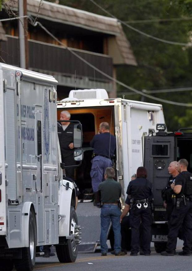 Police gather near an apartment house where the suspect in a shooting at a movie theatre lived in Aurora, Colo., Friday, July 20, 2012.