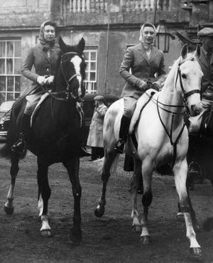 File photo dated 18/04/1959 of Queen Elizabeth II (left) and Princess Margaret going out for their morning ride in Badminton Great Park before the start of the day's events in the Badminton Horse Trials. PRESS ASSOCIATION Photo.