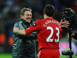 LONDON, ENGLAND - FEBRUARY 26:  Kenny Dalglish manager of Liverpool celebrates victory with Jamie Carragher after the Carling Cup Final match between Liverpool and Cardiff City at Wembley Stadium on February 26, 2012 in London, England. Liverpool won 3-2 on penalties.  (Photo by Mike Hewitt/Getty Images)