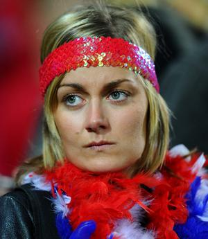 WELLINGTON, NEW ZEALAND - OCTOBER 01:  A dejected France fan looks on following her team's 14-19 defeat during the IRB 2011 Rugby World Cup Pool A match between France and Tonga at Wellington Regional Stadium on October 1, 2011 in Wellington, New Zealand.  (Photo by Mike Hewitt/Getty Images)