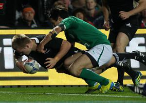 HAMILTON, NEW ZEALAND - JUNE 23:  Sam Cane of the All Blacks scores his first test try during the International Test Match between New Zealand and Ireland at Waikato Stadium on June 23, 2012 in Hamilton, New Zealand.  (Photo by Sandra Mu/Getty Images)