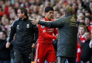 LIVERPOOL, ENGLAND - MARCH 18:  Luis Suarez of Liverpool shakes hands with Kenny Dalglish, manager of Liverpool as he leaves the field during the FA Cup with Budweiser Sixth Round match between Liverpool and Stoke City at Anfield on March 18, 2012 in Liverpool, England.  (Photo by Alex Livesey/Getty Images)