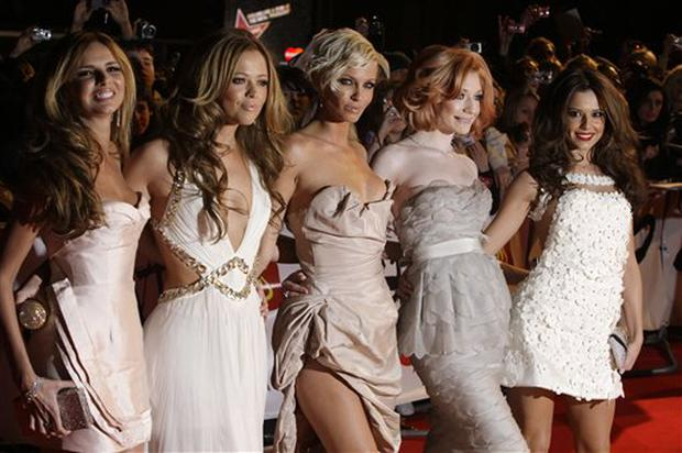British band Girls Aloud, from left, Nadine Coyle, Kimberly Walsh, Sarah Harding, Nicola Roberts and Cheryl Cole arrive at the Brit Awards 2009 at Earls Court exhibition centre in London, England, Wednesday, Feb. 18, 2009. (AP Photo/Joel Ryan)