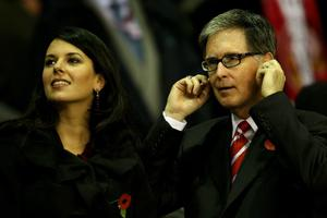 LIVERPOOL, ENGLAND - NOVEMBER 04:  Liverpool Owner John Henry stands with Wife Linda Pizzuti  prior to the UEFA Europa League Group K match beteween Liverpool and SSC Napoli at Anfield on November 4, 2010 in Liverpool, England.  (Photo by Clive Brunskill/Getty Images)